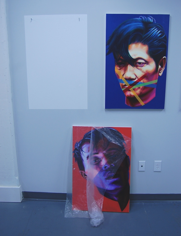 "Hanging and ""removed"" artwork from the ""Censored"" series by Kien Nguyen."