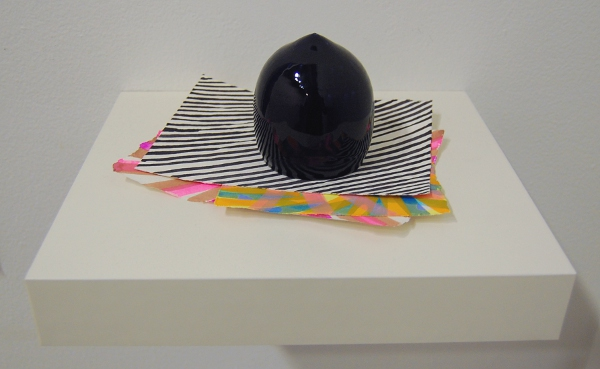 One of Brian Giniewski's paperweights and its unique paper prints.