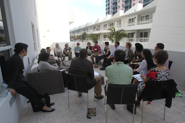 "Erik Takeshita of Local Initiatives Support Corporation - Twin Cities and Gayle Isa of the Asian Arts Initiative in Philadelphia lead a breakout discussion outside on ""Know Your Neighbors: Lessons on Community Advancement from Community Organizing."""