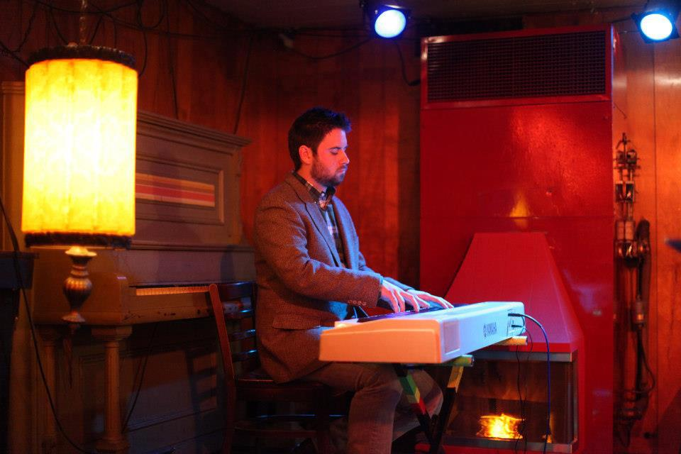David Mercer at the piano in the January 2013 reading at the Turf Club. Photo by Sharyn Morrow, courtesy of Riot Act Reading Series.