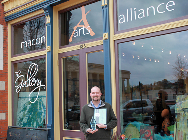 Holding the Gold Addy Award and Gold Addy Certificate outside Macon Arts Alliance. Photo by Jim Burt.