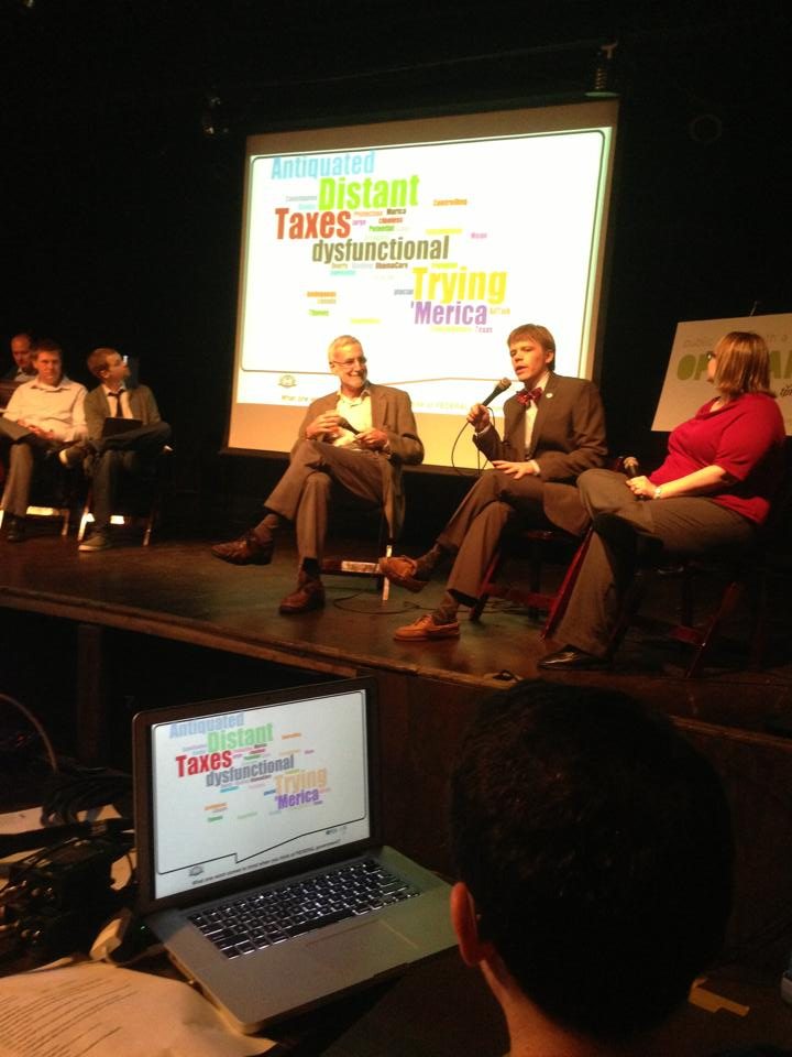 "A crowdsourced word cloud about the constitution at ""Red, White and Brew"". Pictured at far right: Theater of Public Policy founder and director Tane Danger (middle) with Eric Black (left) and Alisa Rosenthal (right); the T2P2 improv players at the far left. Photo courtesy of Open Air."