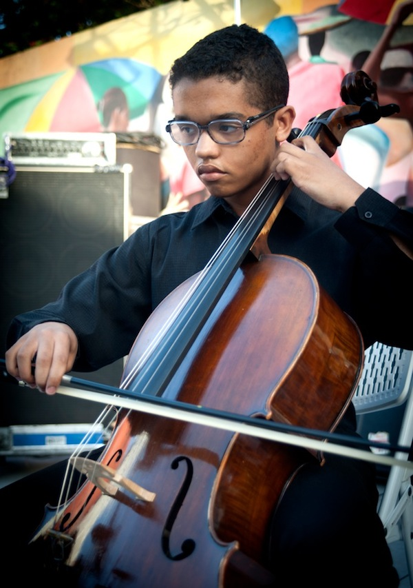 Luc-Olivier Vaval, a young cellist who attends New World School of the Arts, played a Bach Cello Suite. Photo by Luis Olazabal