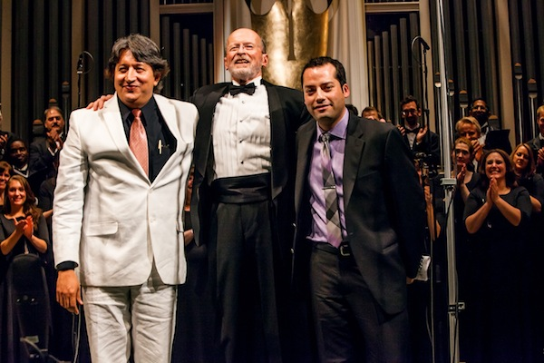 Composers Novelli Jurado (left) and Gerardo Cárdenas (right) take final bows at the ¡Cantaré! Community Concert with VocalEssence Artistic Director Philip Brunelle.
