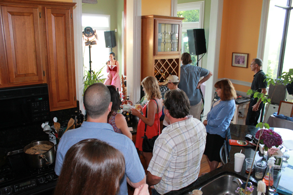 Some audience members enjoy the show from the the kitchen of the historic home where Bastian played.