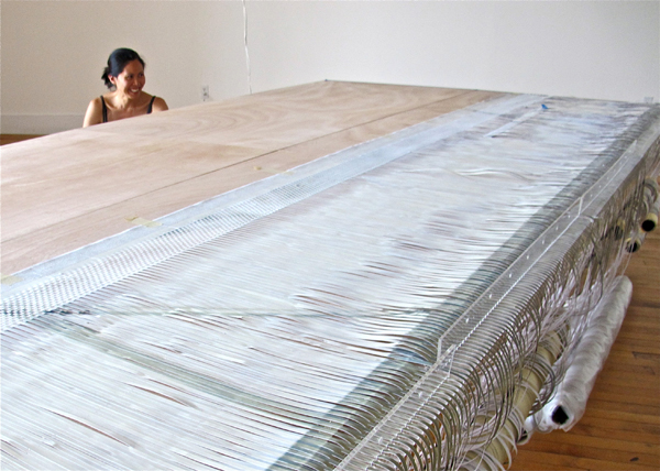 The artist drew upon her design experience for multiple aspects of the project, including the architecture of the original factory and the creation of the table loom.