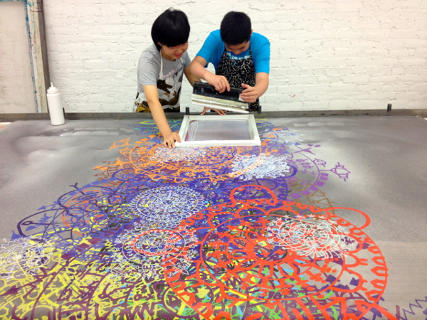 Jingwen and Benxin working hard to screen print their design on the picture. Photo courtesy emojienergy.blogspot.com